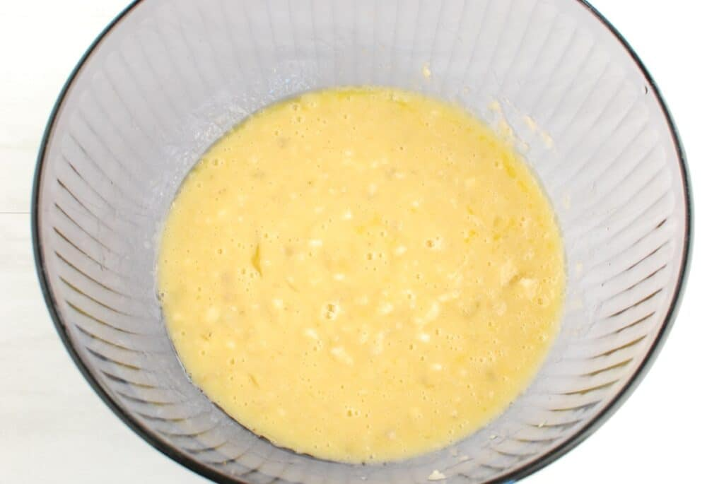 All the wet ingredients for banana muffins in a bowl.