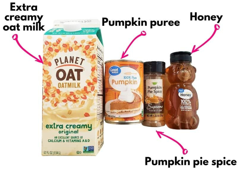 A container of oat milk, a can of pumpkin, pumpkin pie spice, and a honey bear.